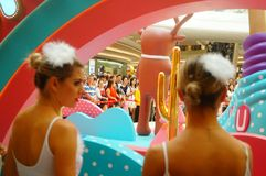 Young female performers perform at the opening ceremony and entertainment of a large shopping mall. In Shenzhen, china royalty free stock image
