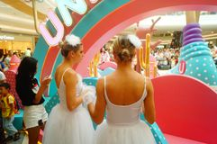 Young female performers perform at the opening ceremony and entertainment of a large shopping mall. In Shenzhen, china stock images