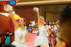 Young female performers perform at the opening ceremony and entertainment of a large shopping mall. In Shenzhen, china stock photo