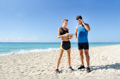 Female personal trainer at the beach. Young female personal trainer at the beach Stock Image