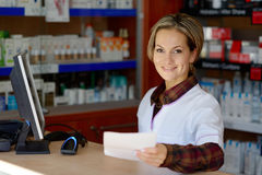 Young female pharmacist holding prescription Royalty Free Stock Photography