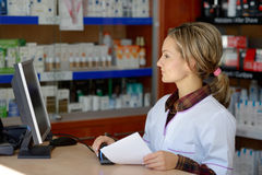 Young female pharmacist indoors Stock Image