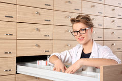 Young female pharmacist portrait Stock Image