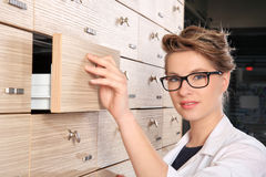 Young female pharmacist portrait Royalty Free Stock Images