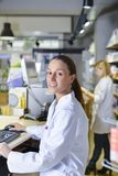 View of an attractive pharmacist at work royalty free stock image