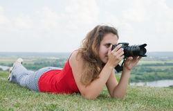 Young female photographer Royalty Free Stock Image