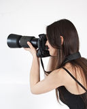 A young female photographer. With a professional camera Stock Photography