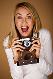 Young female photographer. Royalty Free Stock Photo