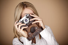 Young female photographer. Stock Images