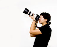 Young female photographer. Taking photos Royalty Free Stock Photography