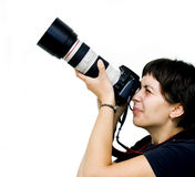 Young female photographer. Taking photos Stock Photo