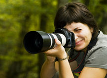 Young female photographer. In autumn forest Royalty Free Stock Photos
