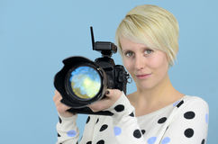Young female photographer with DSLR camera Royalty Free Stock Photo