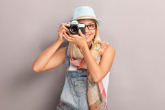 Young female photographer photographing Royalty Free Stock Image
