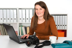 Young female photographer Stock Images