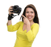 Young female photographer taking photos looking at new digital c Royalty Free Stock Images
