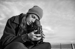 Young Female Photographer Using Vintage Camera Outdoors Stock Photos