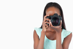 Young female photographer at work Royalty Free Stock Photo