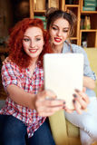 Young female photographing themselves. Young attractive female photographing themselves Stock Photo