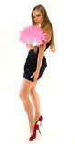 Young female with pink hand fan Stock Image
