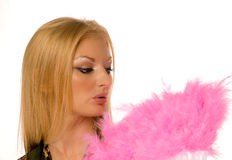 Young female with pink hand fan isolated Stock Photo