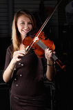 Young female play on violin Royalty Free Stock Photos