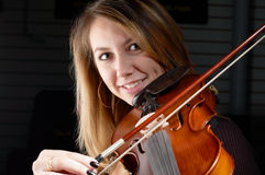 Young female play on violin Stock Images