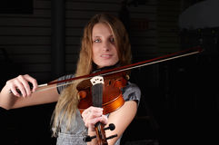 Young female play on violin Royalty Free Stock Image