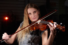 Young female play on violin Royalty Free Stock Images