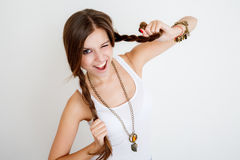 Young female playing with her braids Royalty Free Stock Photography