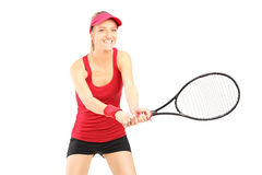 A young female playing tennis Stock Images