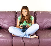 Young female playing video-games Stock Photo