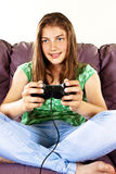 Young female playing video-games Stock Images