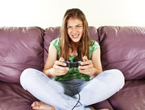 Young Female Playing Video-games Royalty Free Stock Images