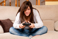 Young female playing video-games home Stock Photo