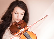 Young female playing the violin. royalty free stock photography