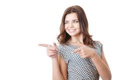 Young female pointing sideways Royalty Free Stock Photography