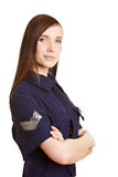 Young female police officer. Smiling with arms crossed Royalty Free Stock Image