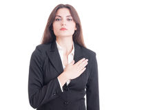 Young female politician or lawyer making an oath Stock Photo