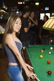Young female at pool table. Stock Photos