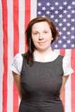 Young female portrait with usa flag as background Stock Photography