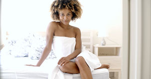 Young Female Posing On Bed Stock Photos