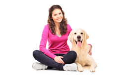 Young female posing with a labrador retriever Royalty Free Stock Image