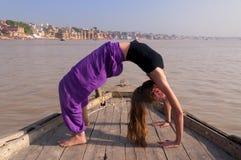 Young female practising yoga posture Urdhva Dhanurasana Royalty Free Stock Photos