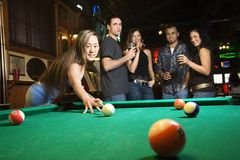 Young Female Preparing To Hit Pool Ball. Royalty Free Stock Images