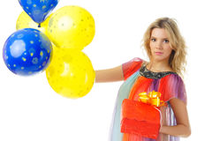 Young female with present and balloons Royalty Free Stock Images