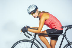 Young female professional cycling athlete posing with racing bik Stock Images