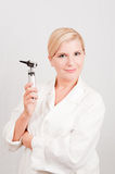 Young female professional doctor with medical tool Royalty Free Stock Image