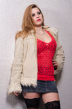 Young female prostitute standing on the street royalty free stock photography