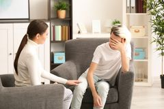 Young female psychologist working with teenager  boy in office. Young female psychologist working with teenager boy in office Stock Photo